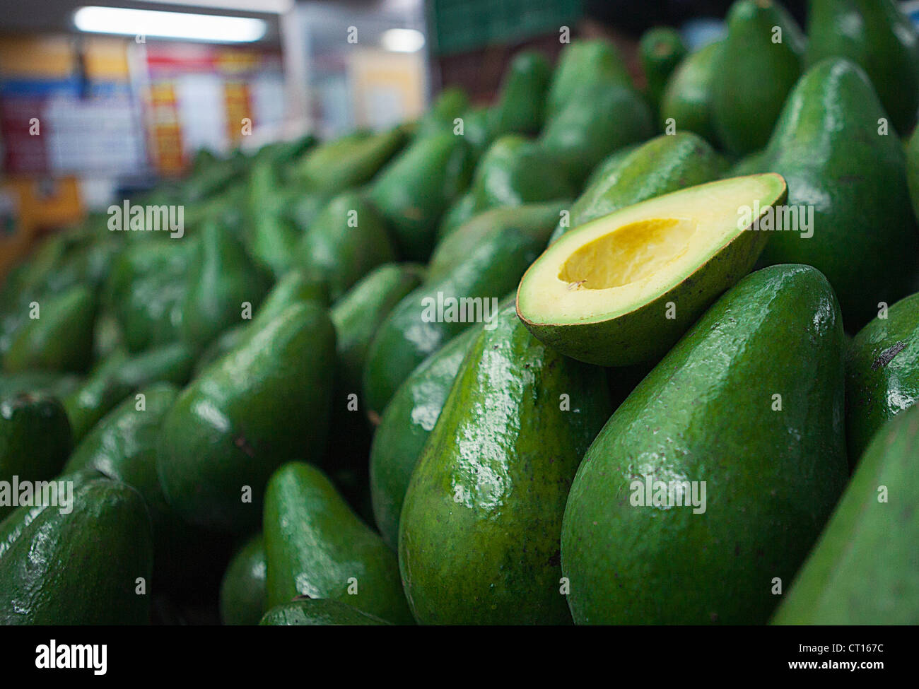 Close up of sliced avocado for sale - Stock Image