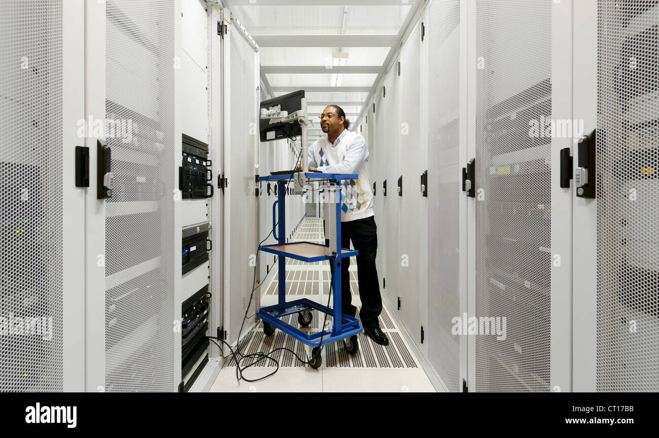 Businessman using computer with servers Stock Photo