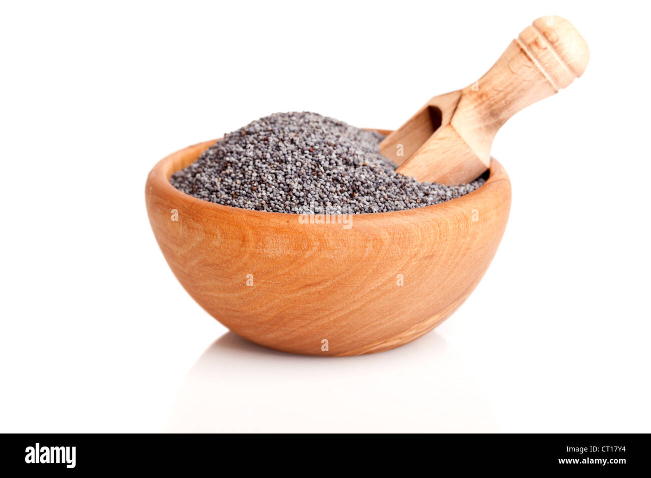 poppyseed in the wooden bowl with spoon, on a white background - Stock Image