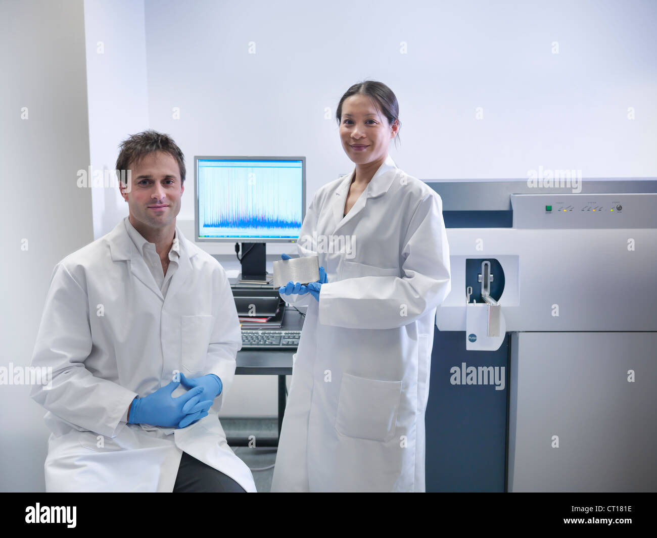 Scientist using computer in lab Stock Photo
