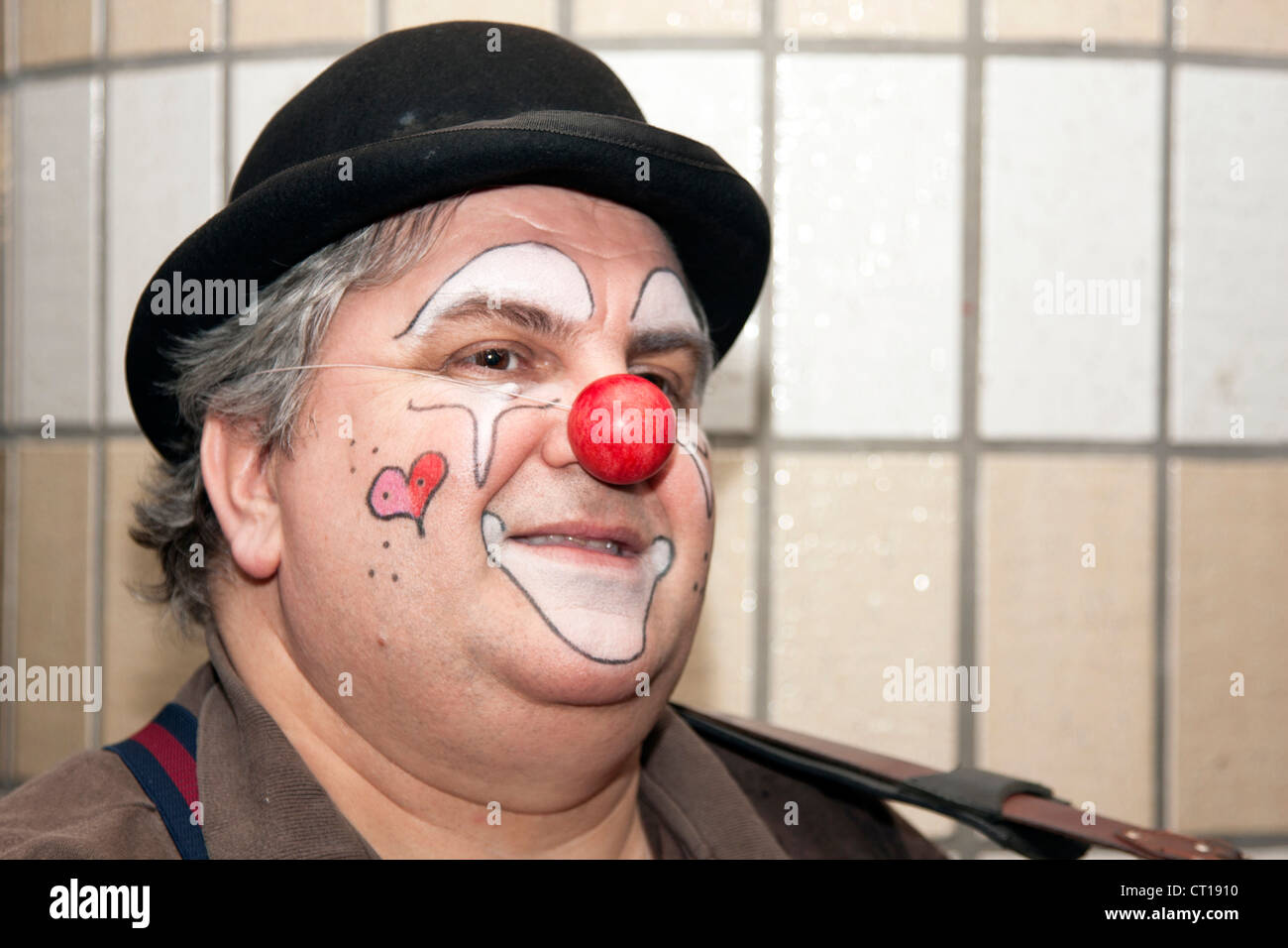 A male in a clown look. - Stock Image