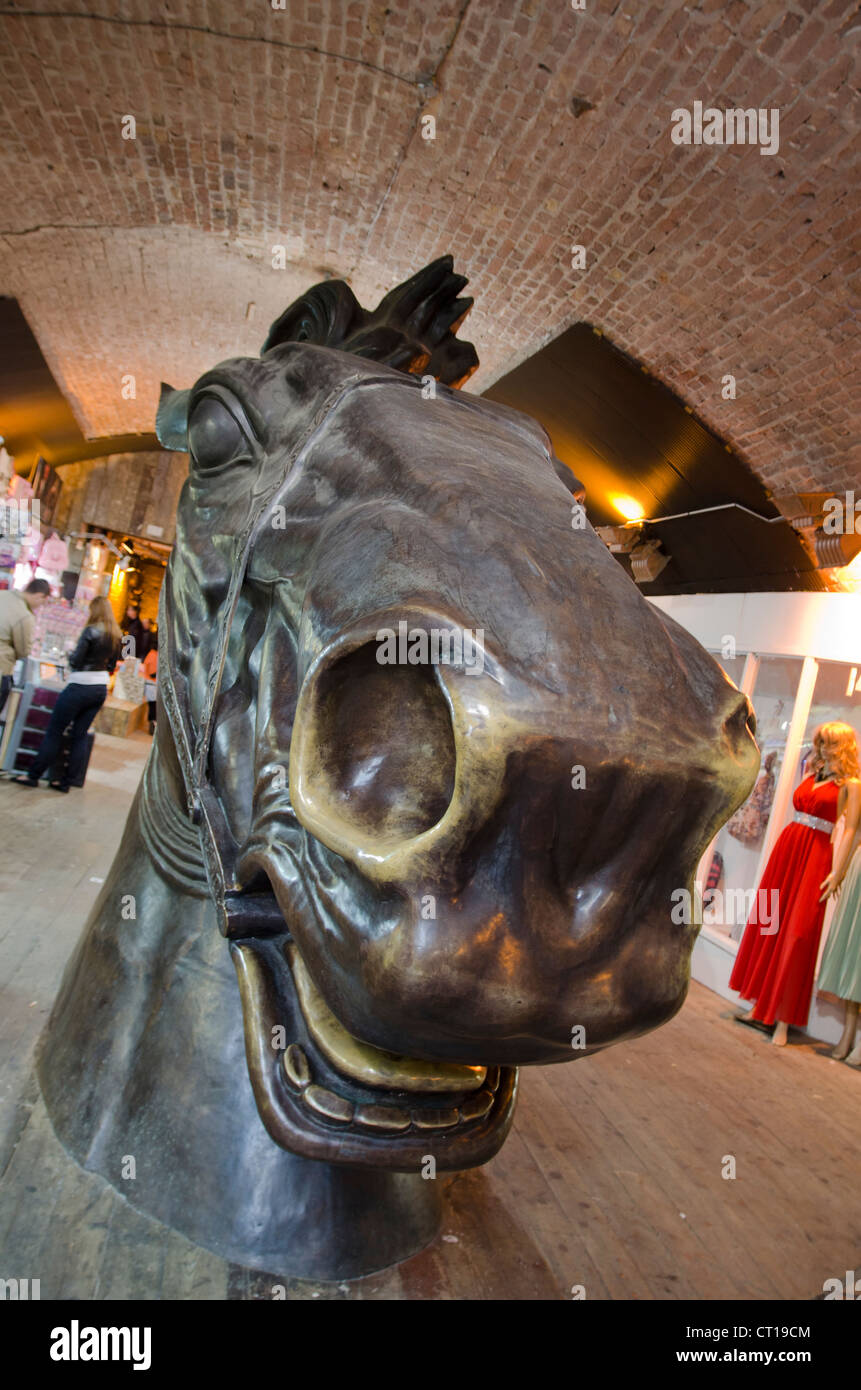 Large bronze sculpture of a horse's head in Camden's stable market Stock Photo
