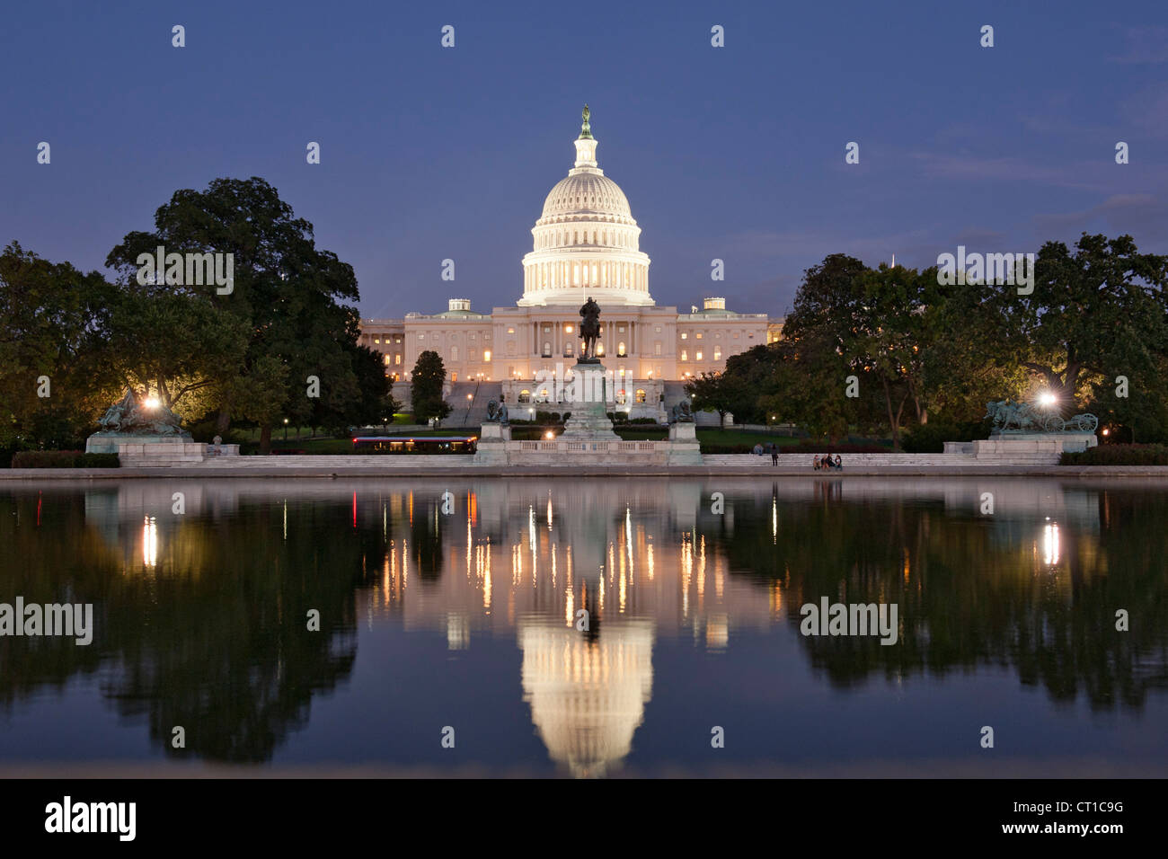 Capitol building reflected in the reflecting pool in Washington DC, USA. - Stock Image