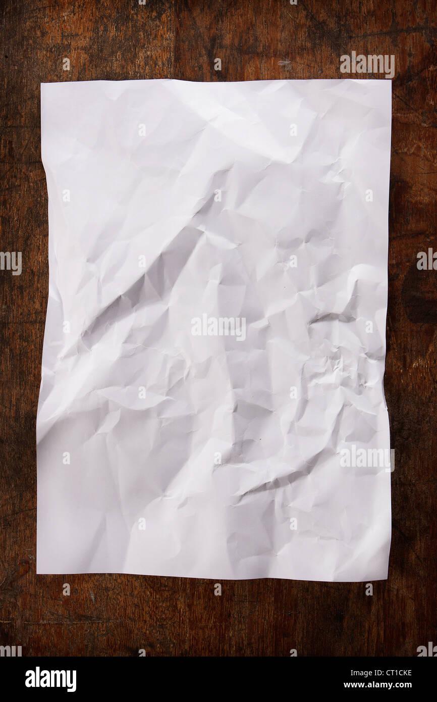 white sheet texture on wood background - Stock Image
