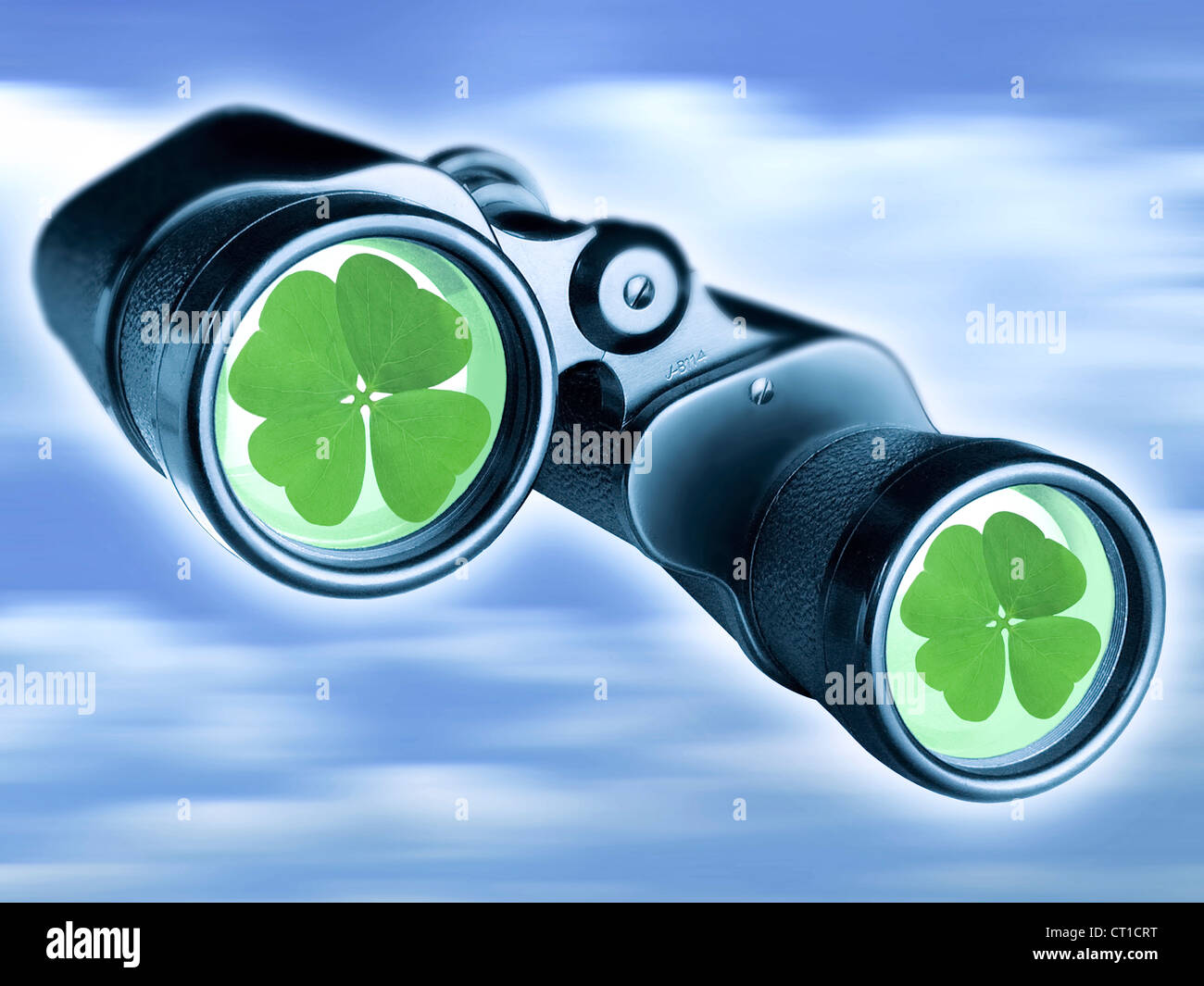 binoculars with four leaved clover on the front glasses - Stock Image