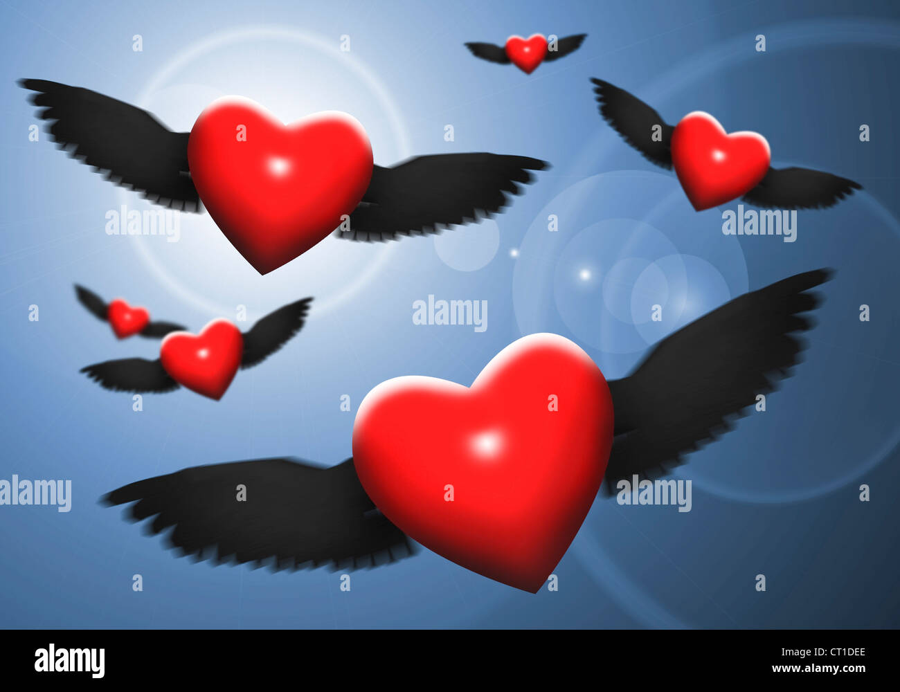 red hearts with wings in the night sky Stock Photo