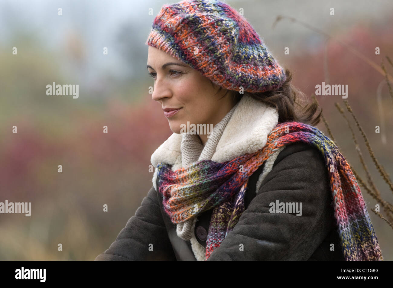 Woman wearing knitted hat and scarf - Stock Image