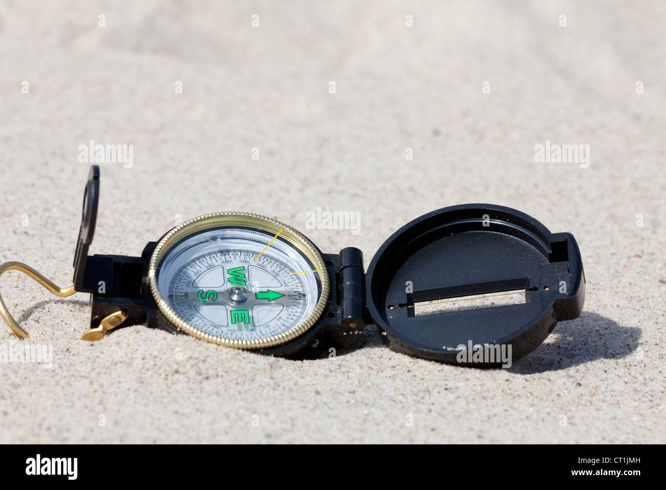 Compass in the hot desert - Stock Image