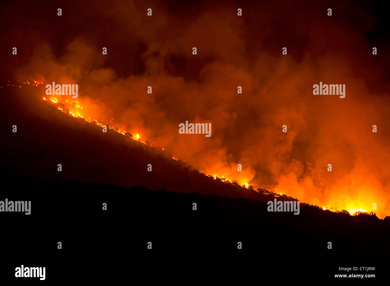 Mountain Forest Fire at night destroys thousands of acres Near Fountain Green in Utah, causing intense raging flames Stock Photo