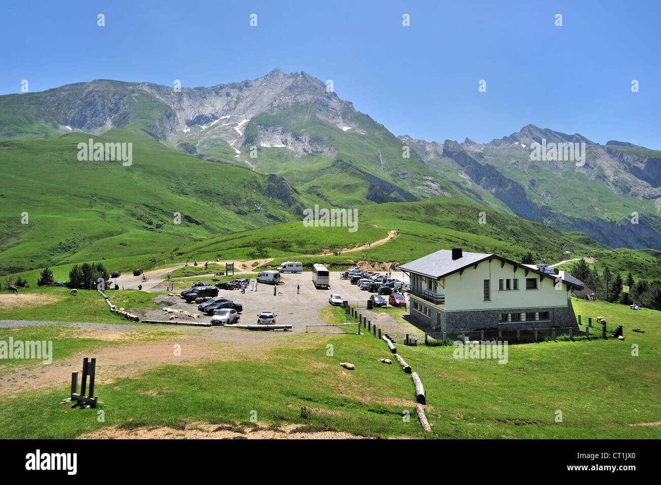 Cars and motorhomes at parking place of restaurant on the Col du Soulor, Hautes-Pyrénées, Pyrenees, France Stock Photo
