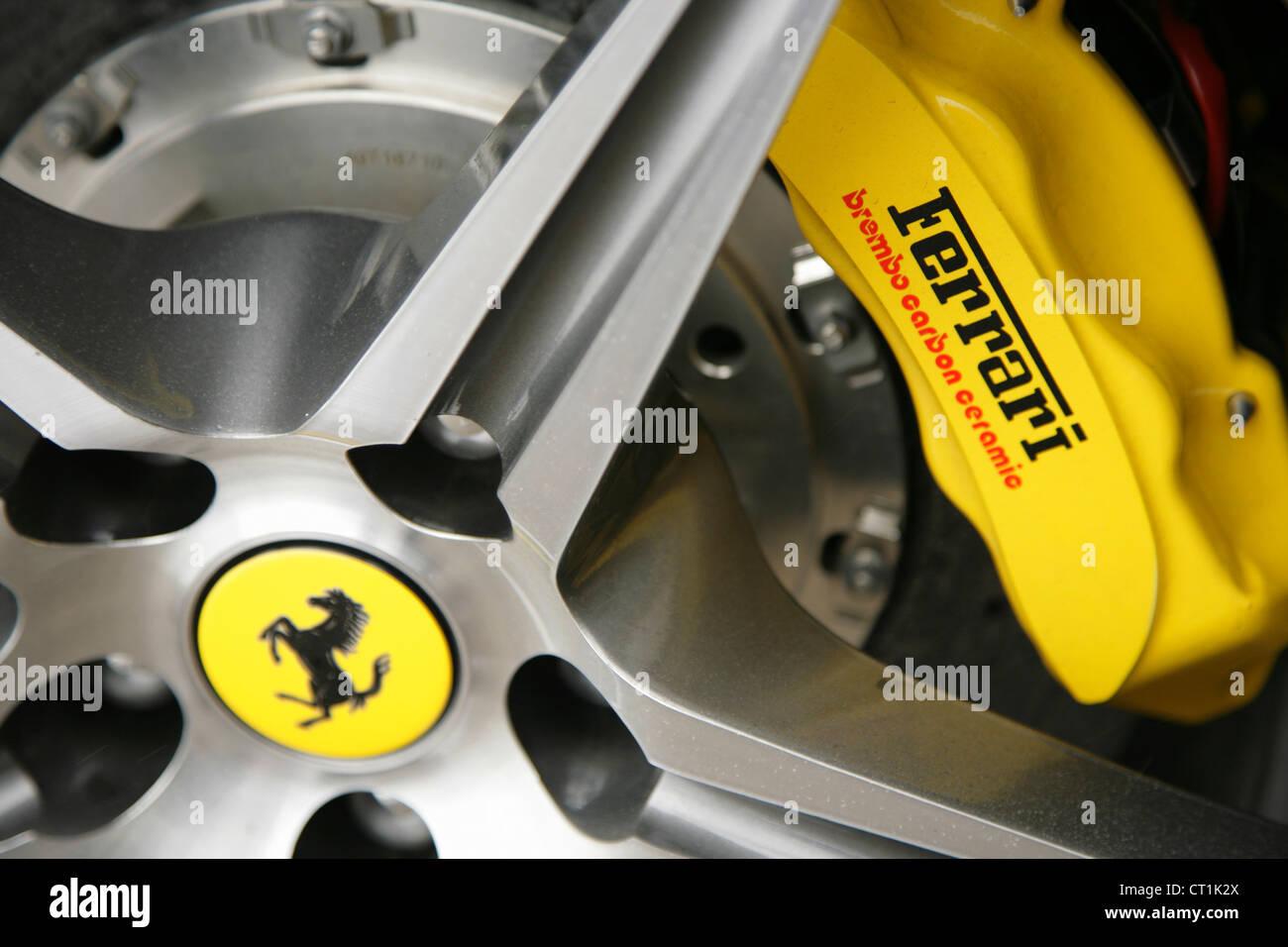 Yellow Brembo brake calipers on Ferrari sportscar Stock