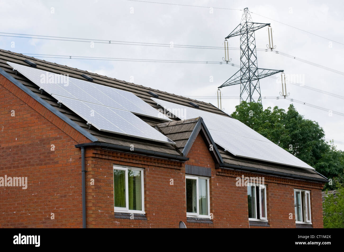 Solar panels on roof of houses in small modern community housing estate Abergavenny, Monmouthshire, South Wales, - Stock Image