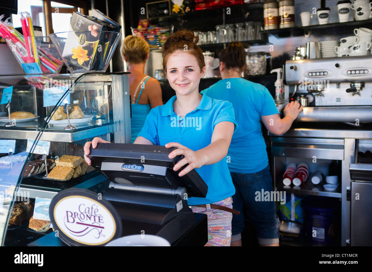 A Happy Smiling 14 Fourteen Year Old Girl Working In A Seaside Stock Photo Alamy