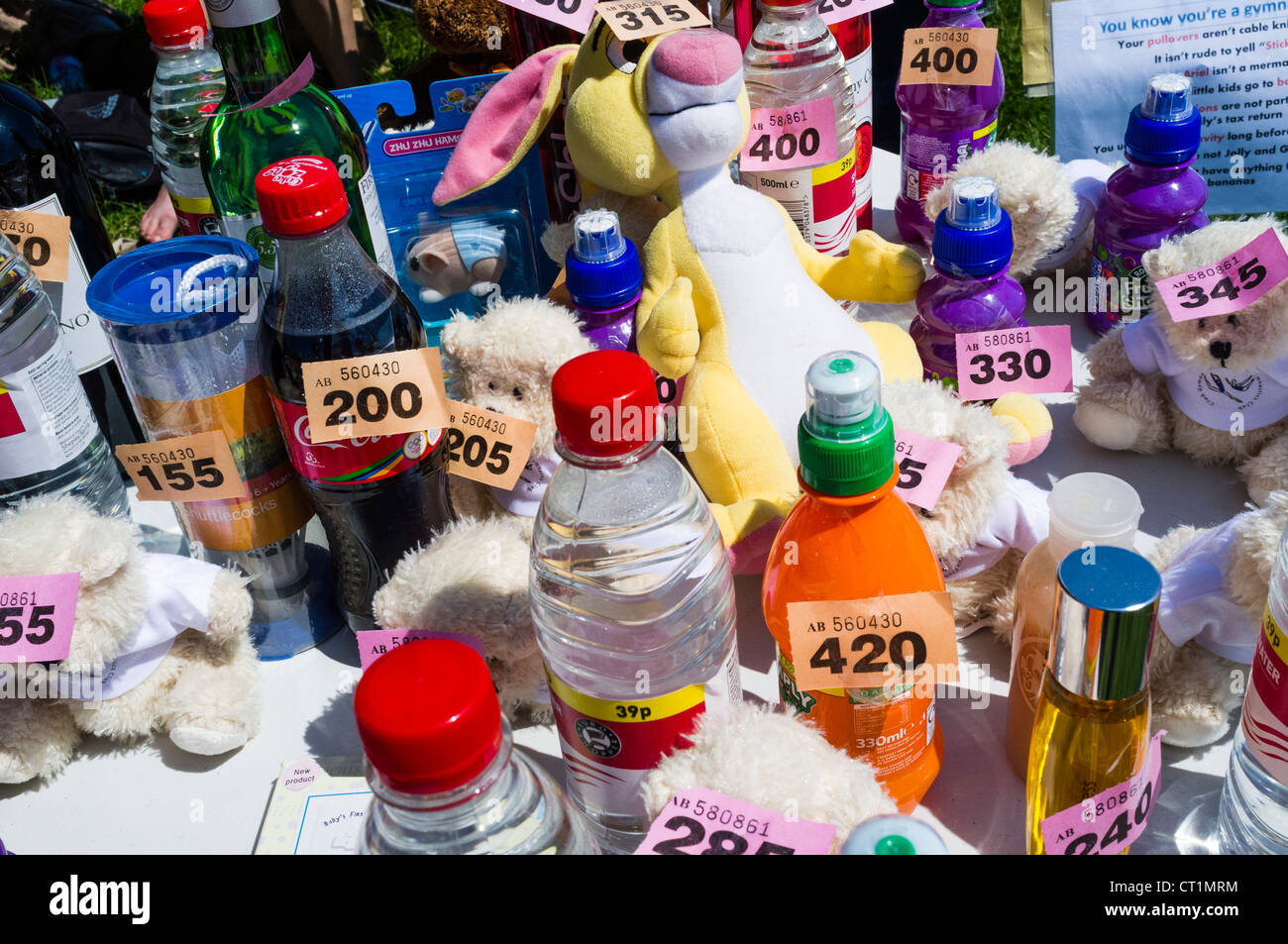 small items being offered as prizes in a village fete raffle tombola uk stock