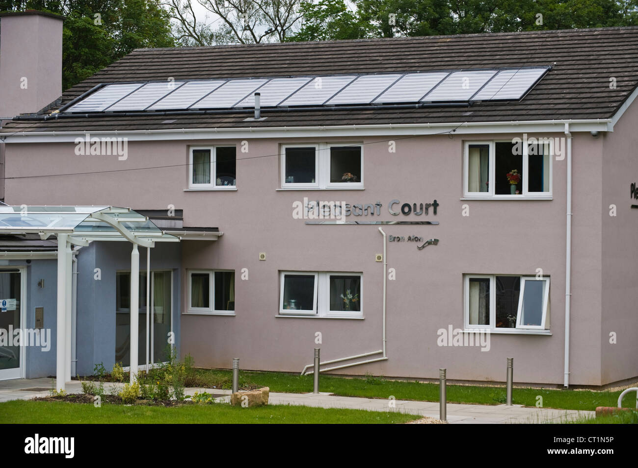 Solar panels on roof of senior citizen community housing at Pontnewynydd Pontypool Torfaen Gwent South Wales UK - Stock Image