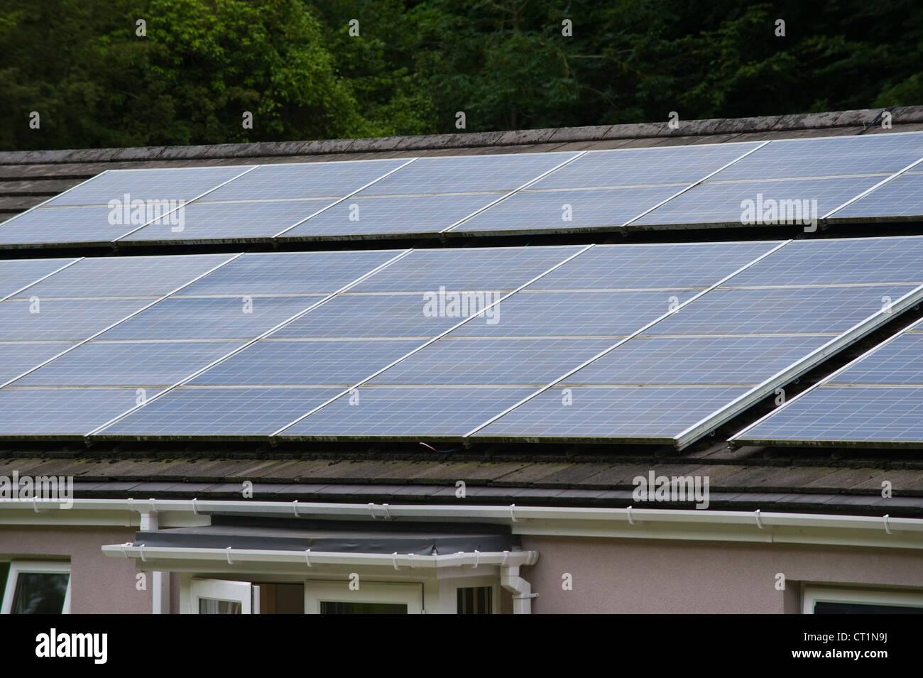Solar panels on roof of senior citizen community housing at Pontnewynydd Pontypool Torfaen Gwent South Wales UK - Stock Image