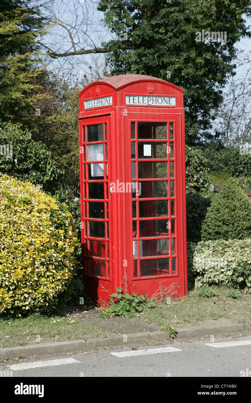 The red telephone box, a telephone kiosk for a public telephone designed by Sir Giles Gilbert Scott - Stock Image