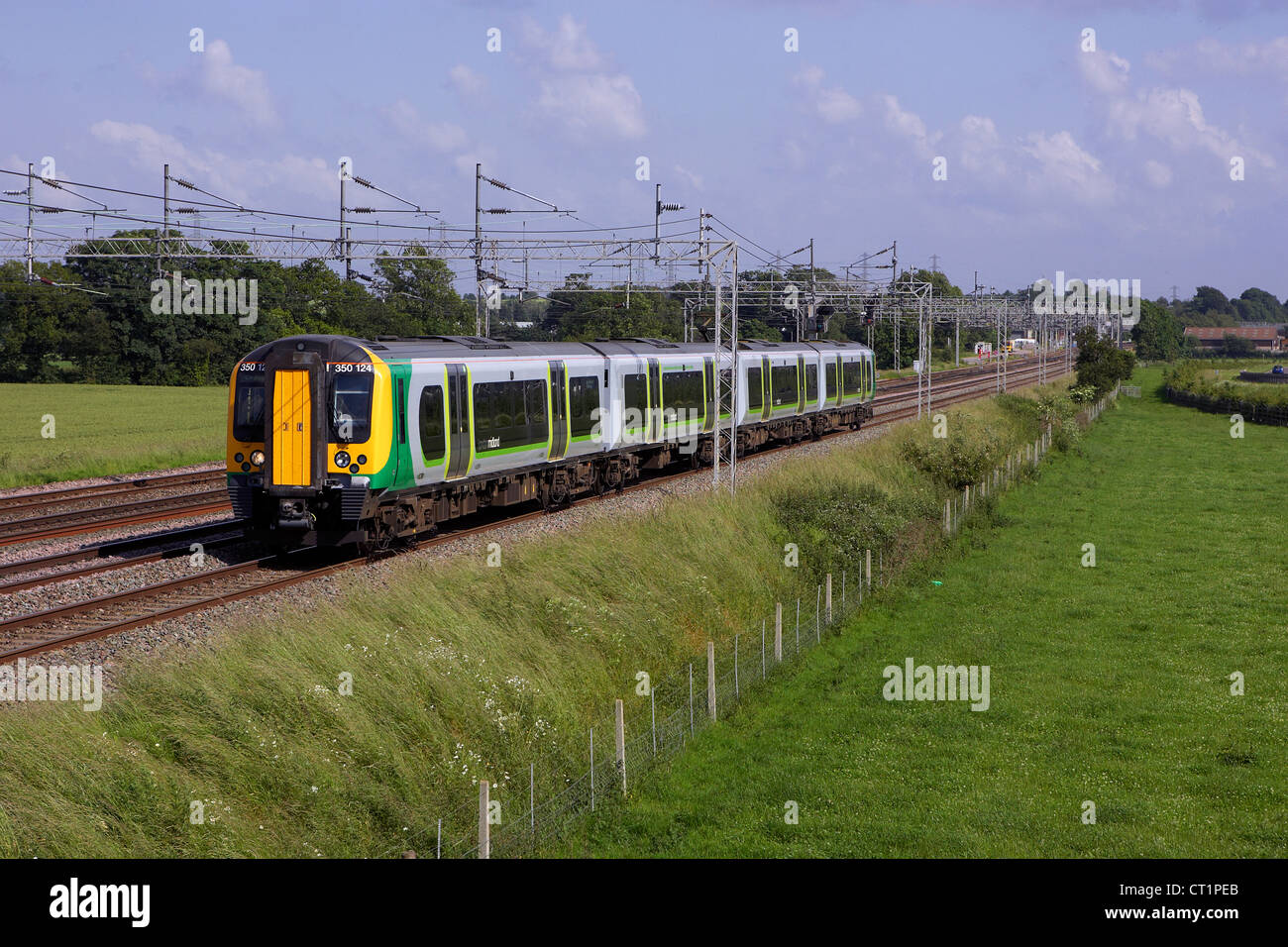 london midland desiro number 350124 heads through Rugeley with a Euston - Crewe service on 28/06/12. - Stock Image