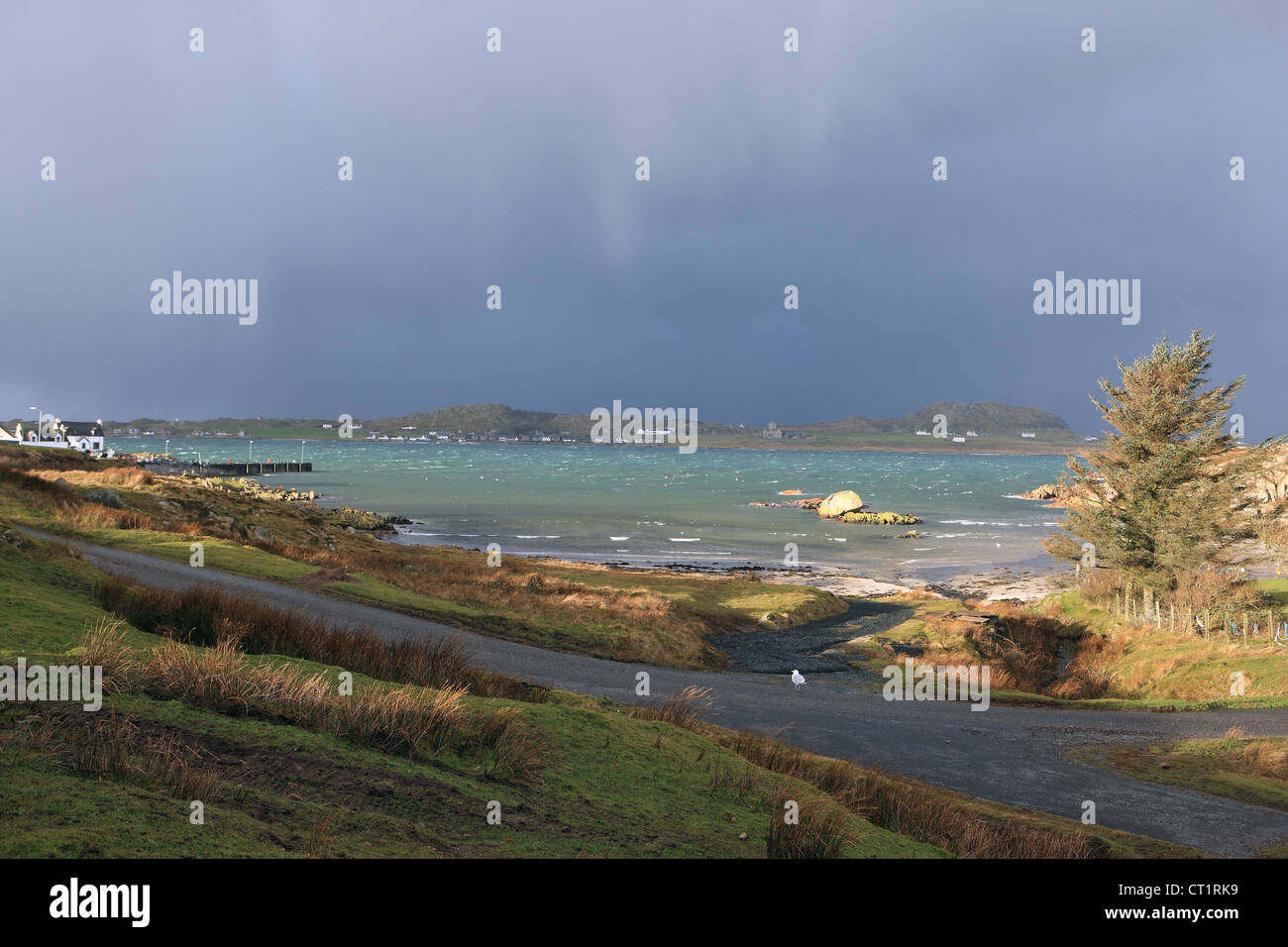 Approaching heavy rain weather system over the Isle of Iona in the Inner Hebrides and taken from Mull - Stock Image