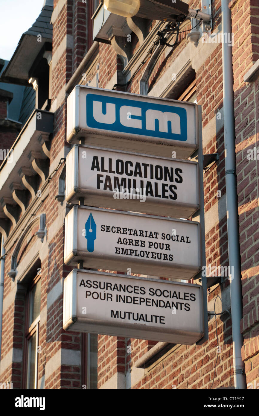 Signs for UCM (which helps with self-employment) on a building in Huy, Walloon Region, Province of Liege, Belgium. - Stock Image