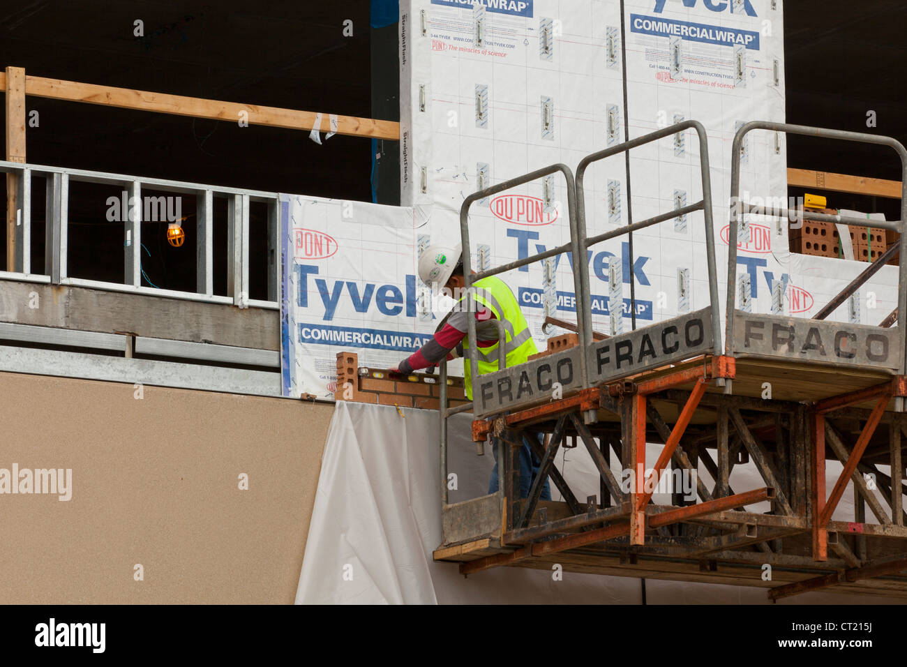 Construction worker on lift - Stock Image
