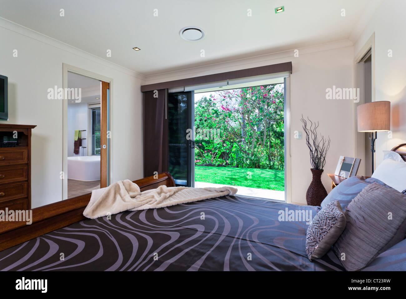 Stylish master bedroom in luxury Australian mansion Stock ...