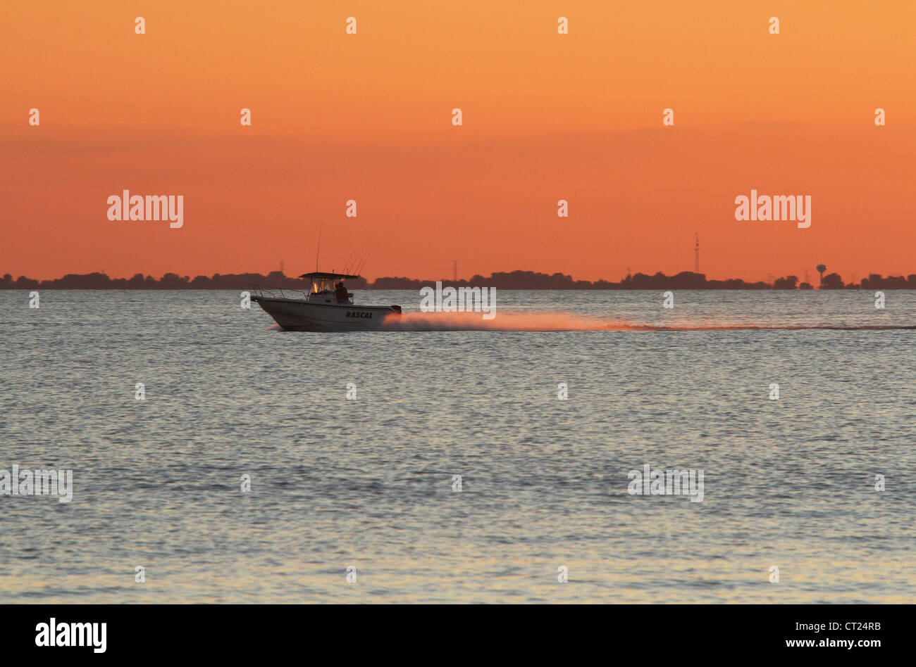 Lake Erie Sunset with Boat. - Stock Image
