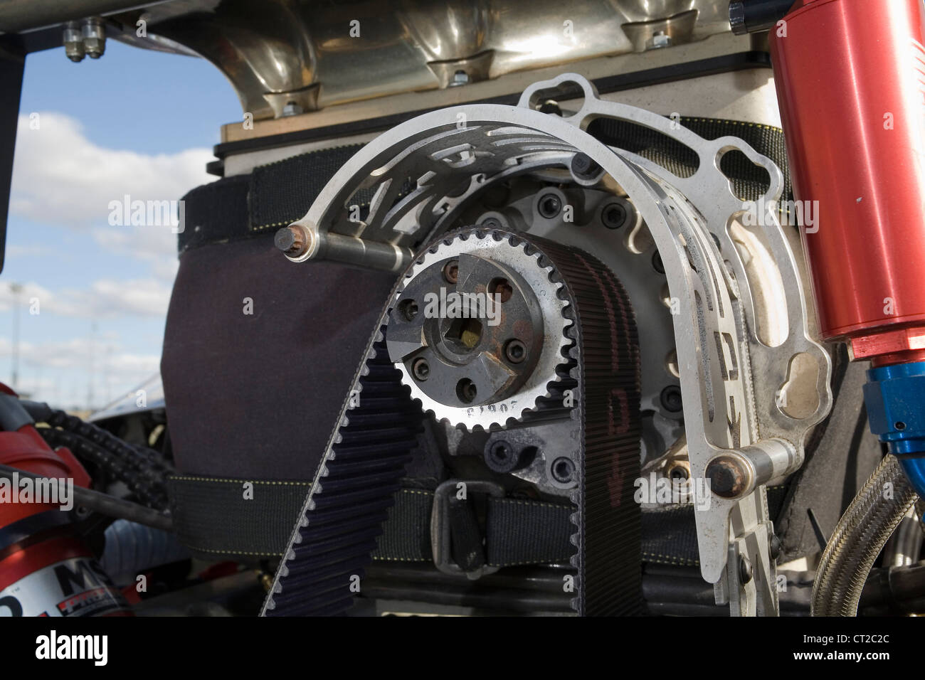 Close up of the belt driven front cog on a supercharger fitted to a drag racing car. - Stock Image