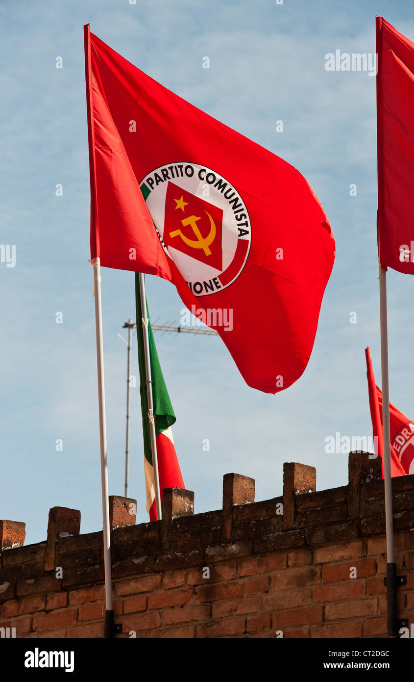 Giudecca, Venice, Italy. The red flag of the PRC (Partito della Rifondazione Comunista) flies for May Day. - Stock Image