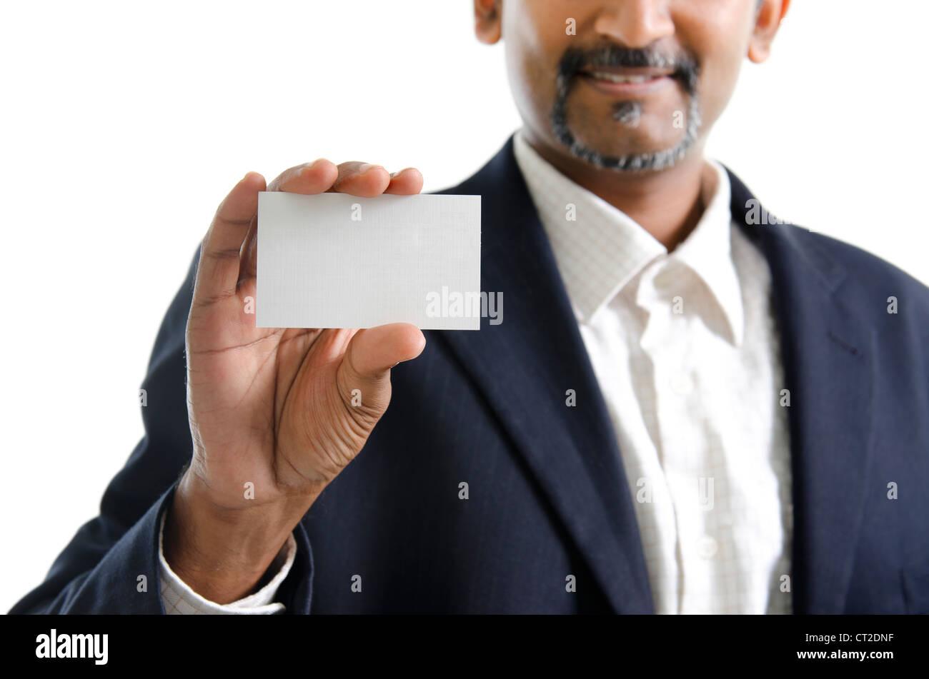 Mature Asian Indian businessman holding business card, focus on hand ...