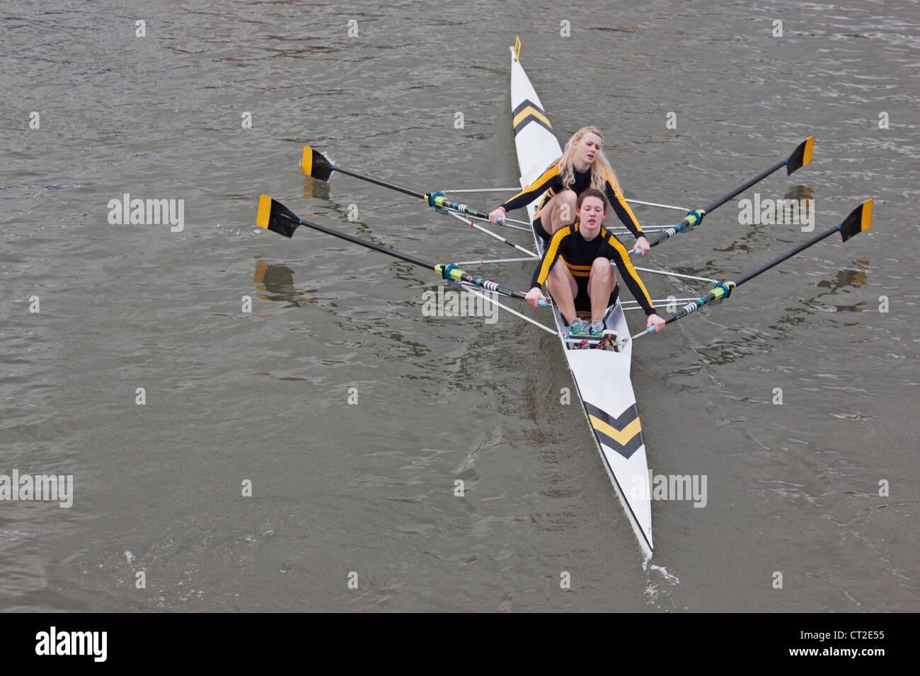 Girl crew pulling in harmony during the annual Head of the River race in Bristol, England - Stock Image