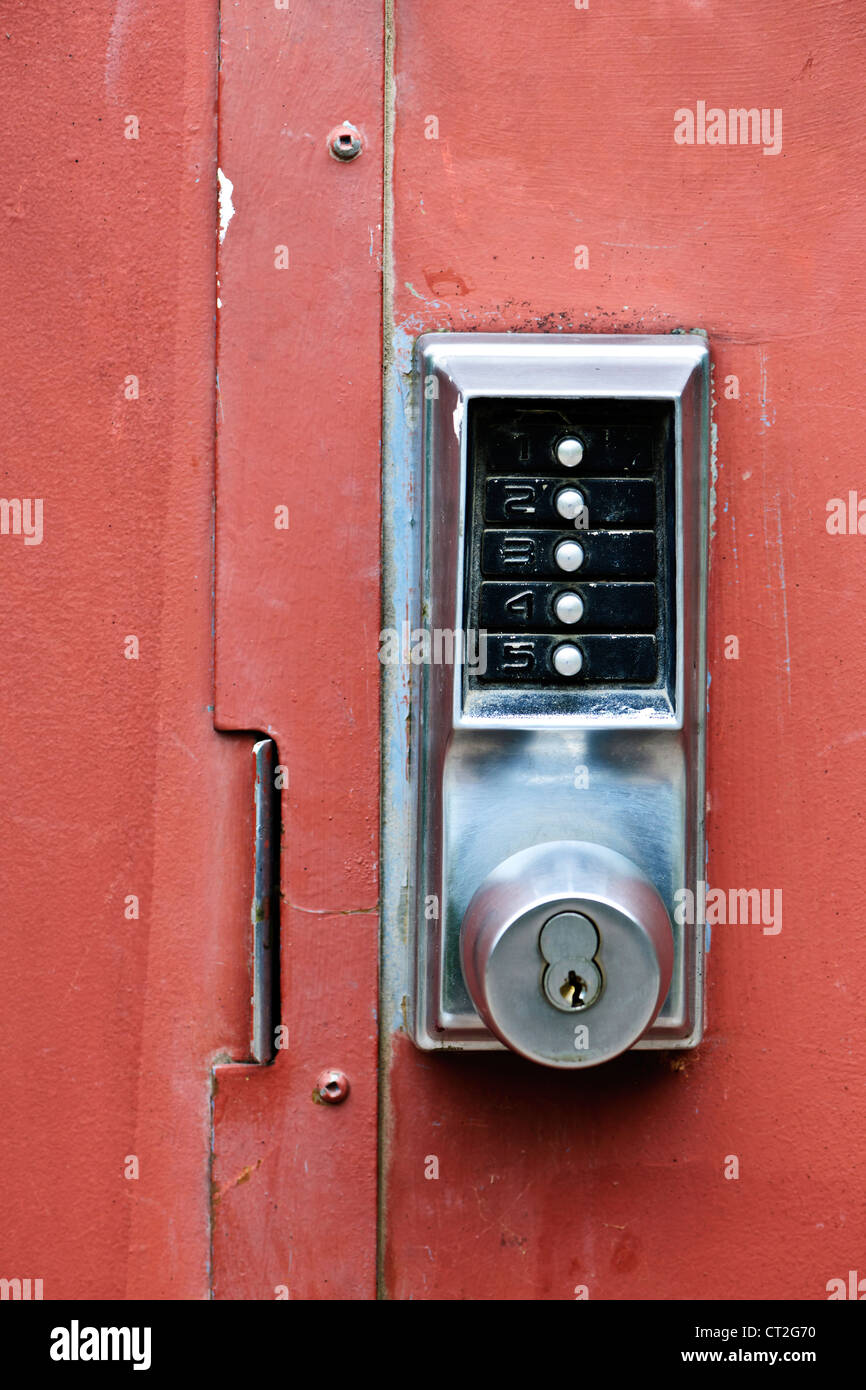 Metal door with push button security lock Stock Photo