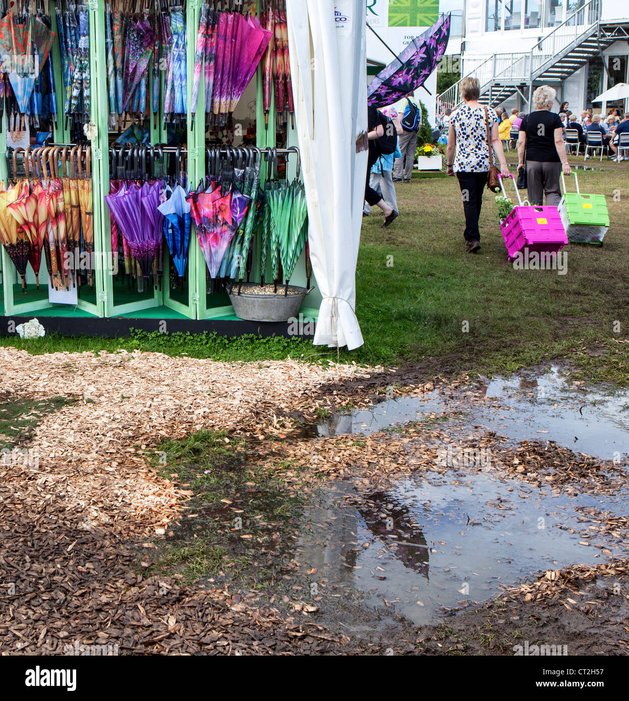 Umbrellas and puddles at the weather challenged Hampton Court Flower Show in July 2012 - Stock Image