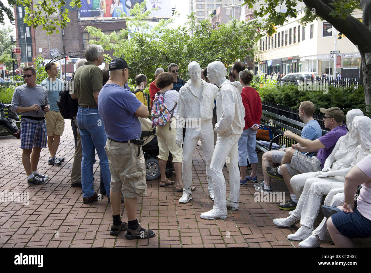 Tour group at the Stonewall Memorial in Greenwich Village near the Stonewall Inn. - Stock Image