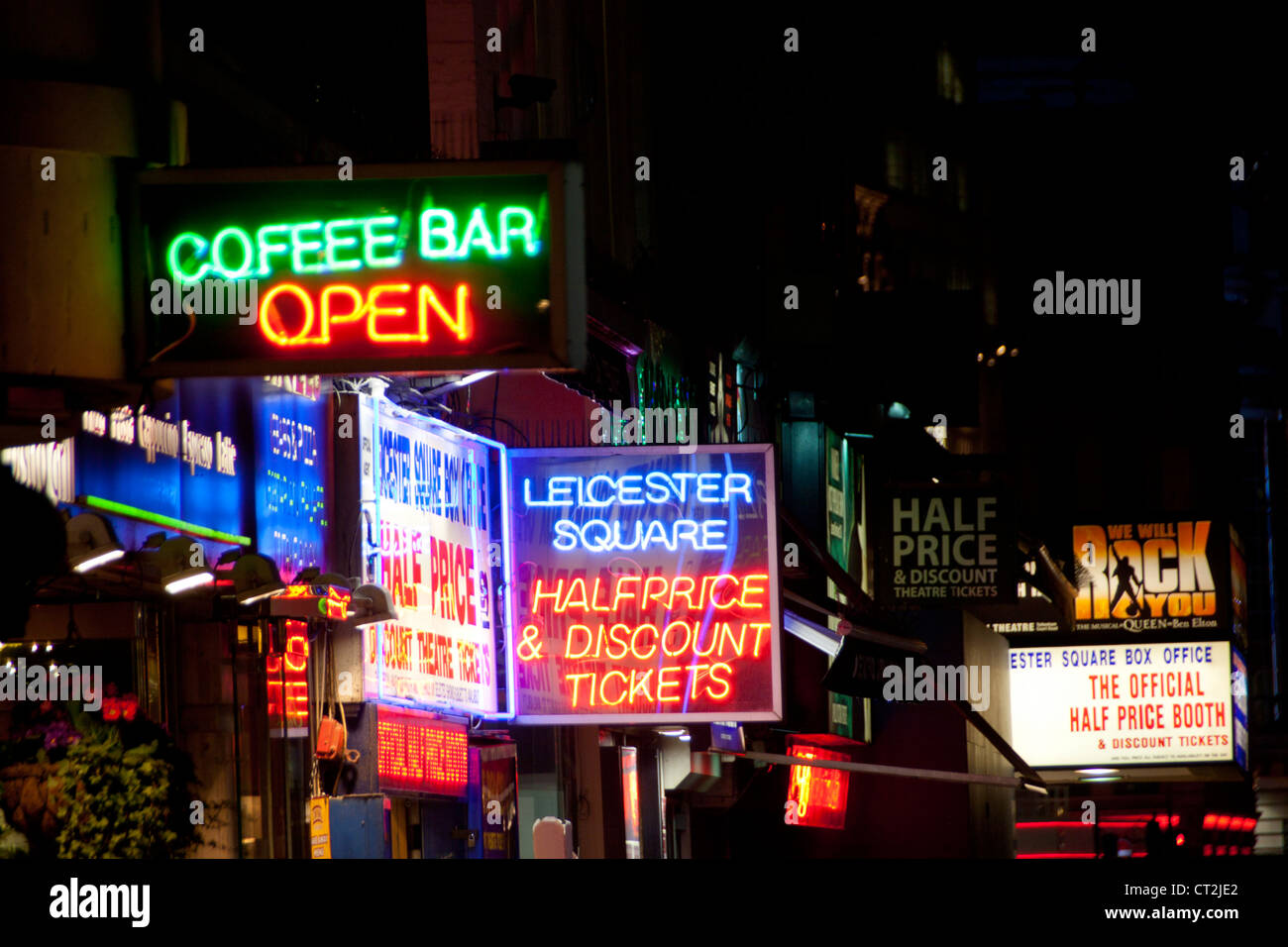 Leicester Square cinema ticket sale booths neon signs at night London England UK - Stock Image