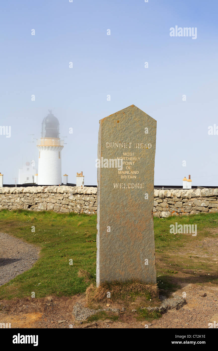 Stone welcome sign for Dunnet Head lighthouse in mist at most northerly point of mainland Britain. Dunnet Caithness - Stock Image