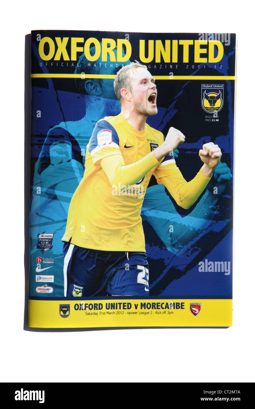 An Oxford United football program from the 2011 - 2012 season, featuring opponents Morecambe. - Stock Image