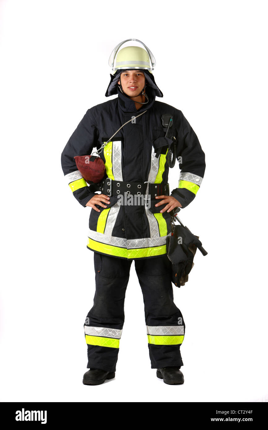 Fire men in protective, fireproof  suit, with fire fighting equipment. Fire service, fire brigade. - Stock Image