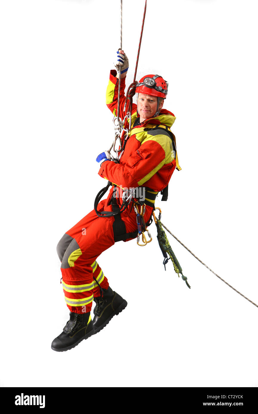 Fire men specialist for rescuing people from heights and out of deep holes. Height savior, fire service, fire brigade. - Stock Image