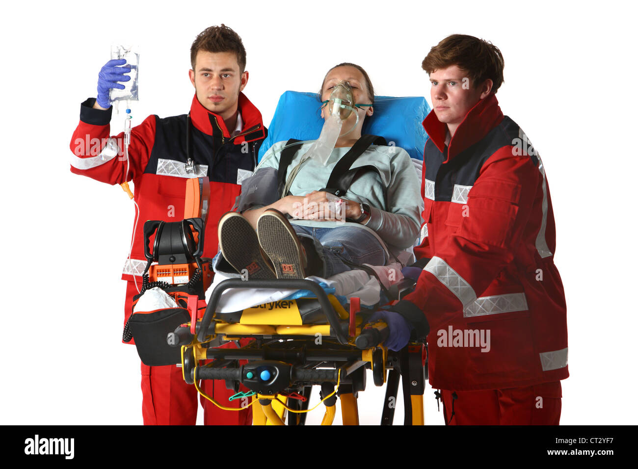 Fire service paramedics, with emergency equipment. - Stock Image