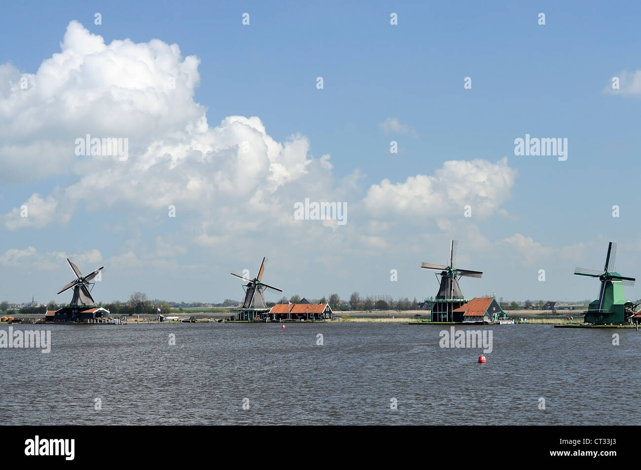 windmills row, Zaanse Schans view of traditional windmills at touristic location, shot in bright spring light - Stock Image
