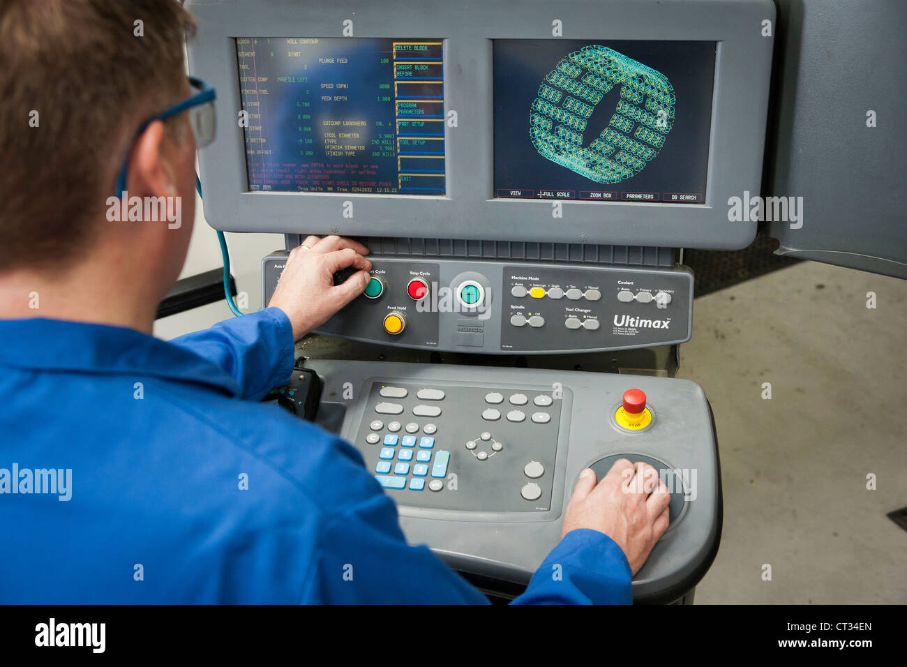 Haas high speed horizontal EDM milling machine with operator - Stock Image