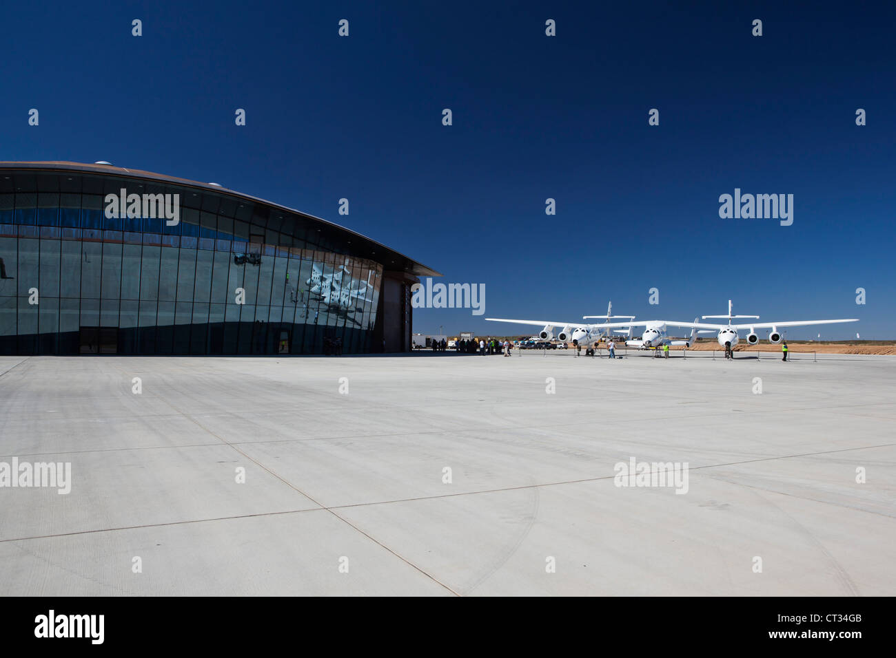 Virgin Galatic's White Knight 2 with Spaceship 2 on the runway at the Virgin Galatic Gateway spaceport, New - Stock Image