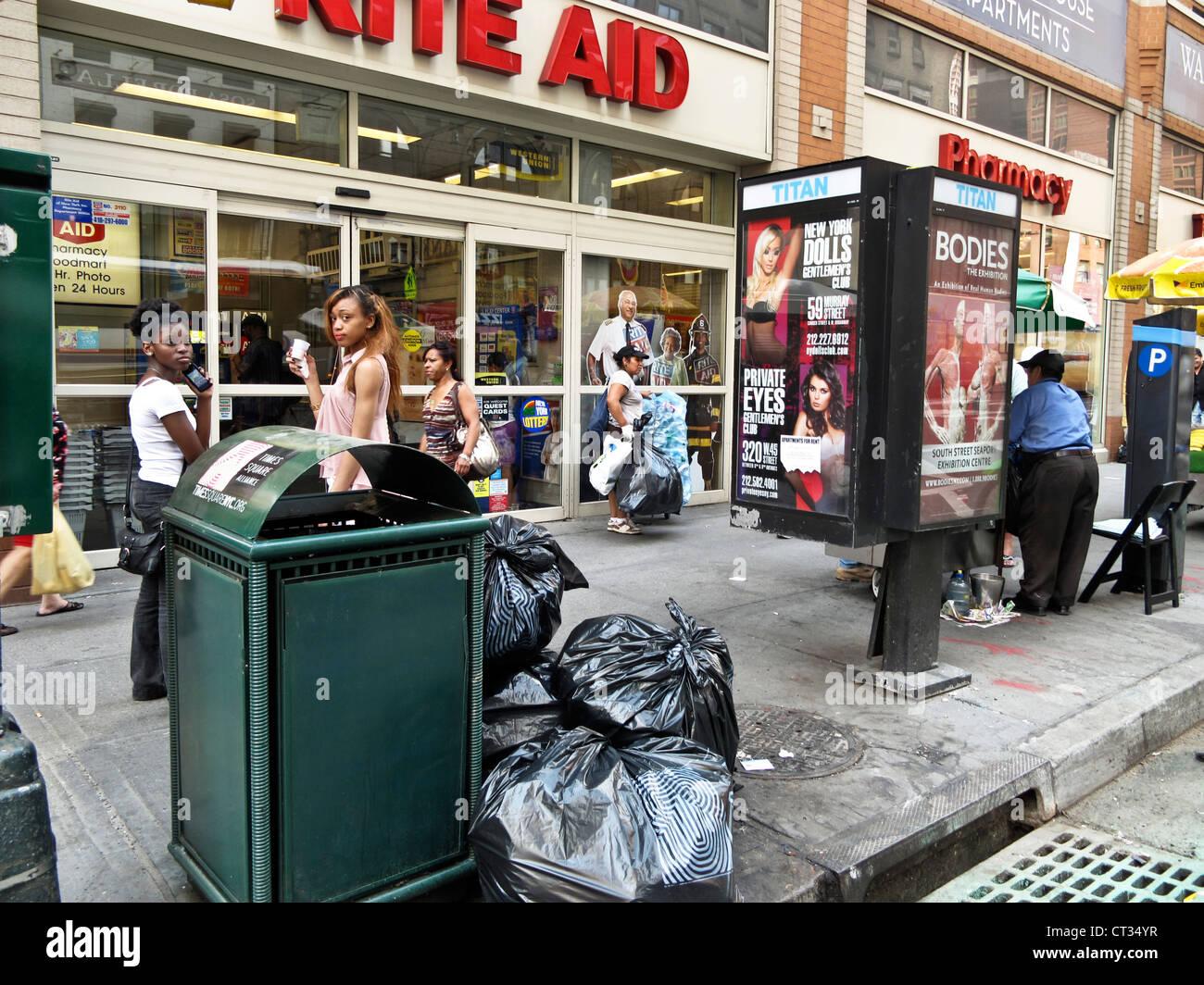 sidewalk street  scene busy 8th Avenue corner on a hot summer day in midtown Manhattan New York City - Stock Image