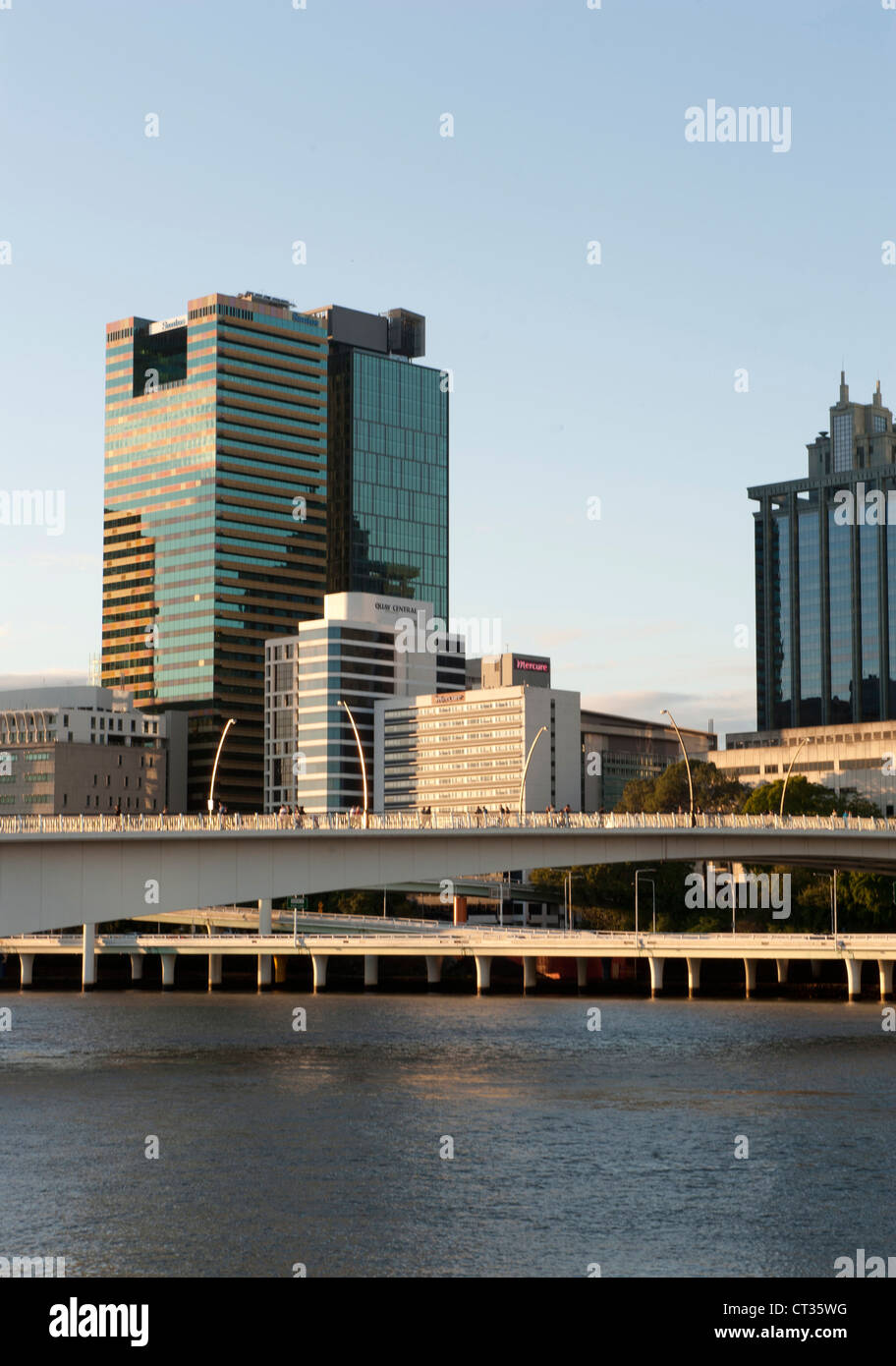 Skyline of the CBD of Brisbane, capital of Queensland, with Brisbane River, seen from South Bank - Stock Image