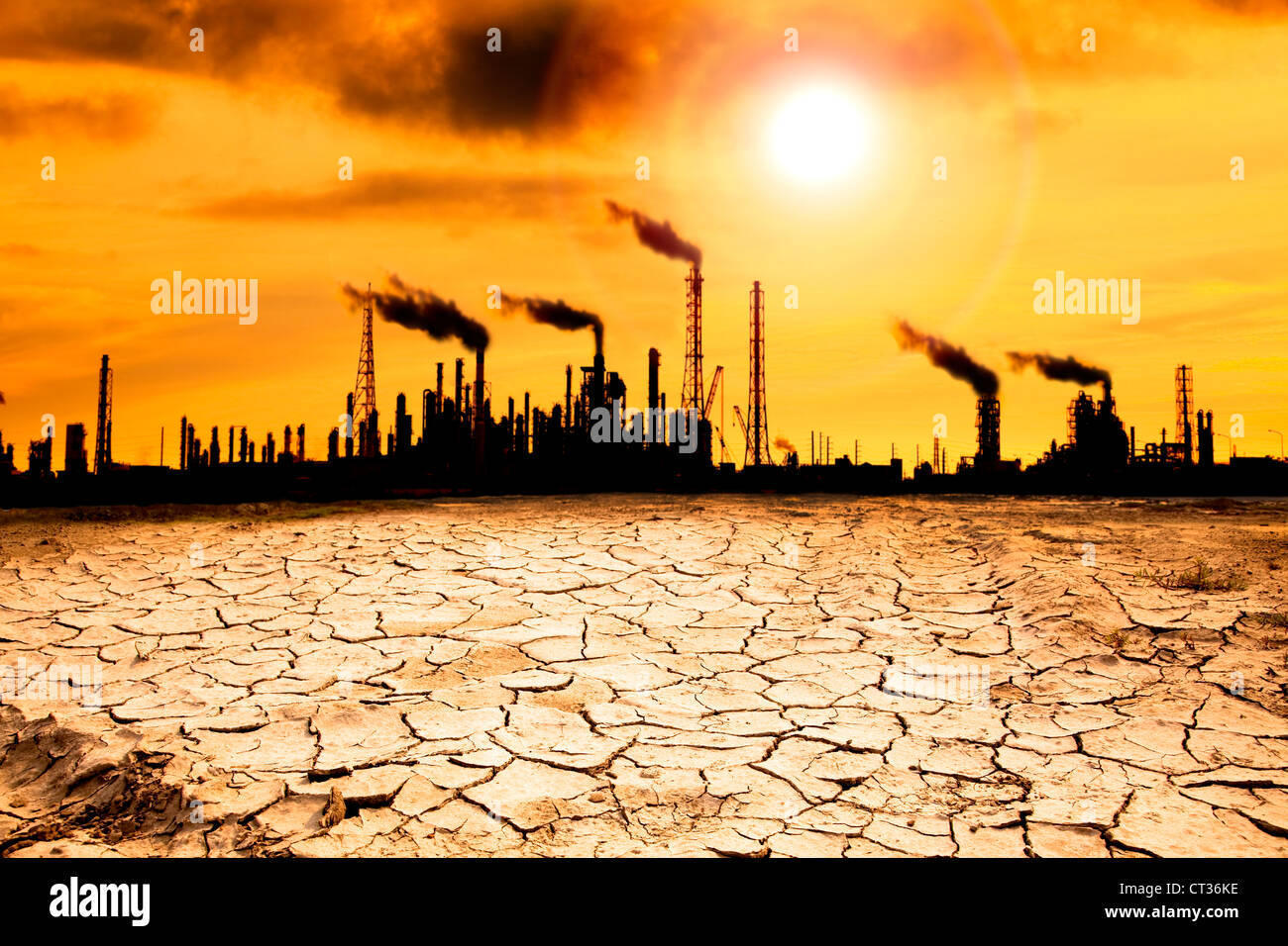 Refinery with smoke and global warming concept - Stock Image