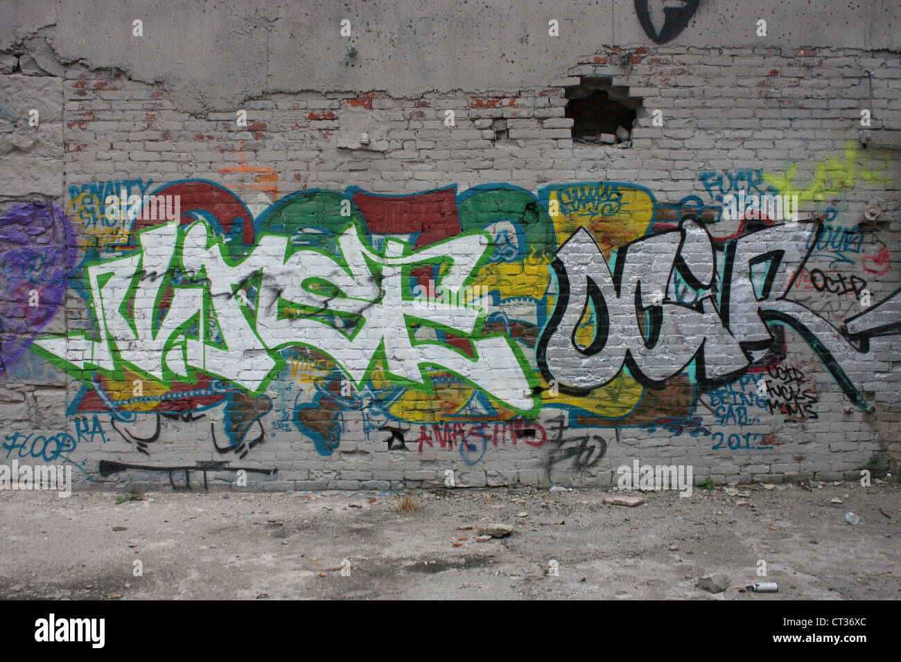 graffiti art brick wall vandalism - Stock Image