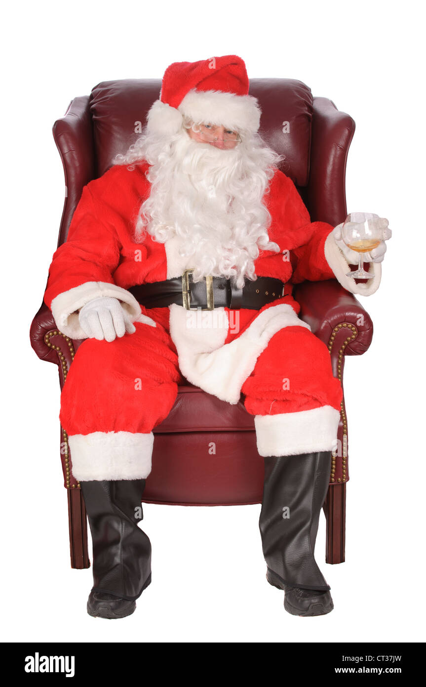 Santa enjoying a rest after a nights work, with a small libation - Stock Image