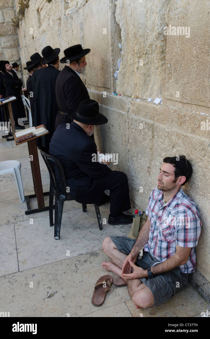 Young man meditating at the Western Wall. Jerusalem Old City. israel. - Stock Image