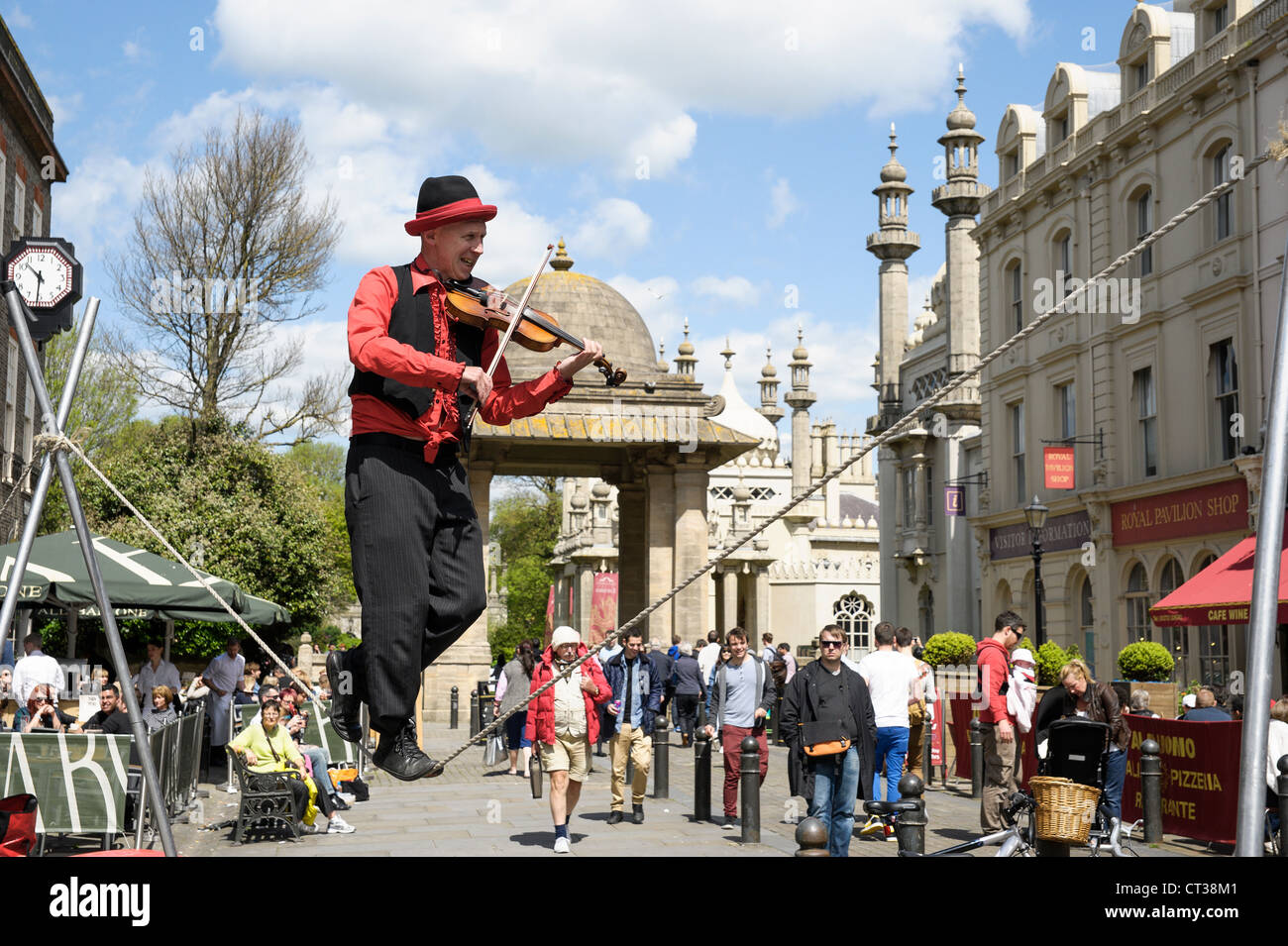 A slack line walker plays the violin in Brighton on 12th May 2012 - Stock Image